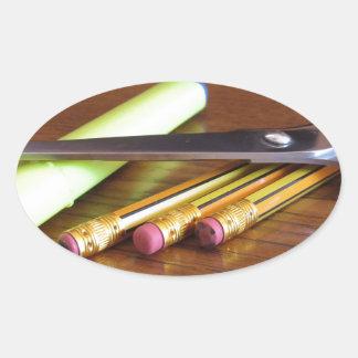 School office supplies on wooden table oval sticker