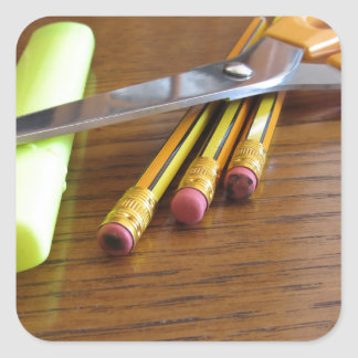 School office supplies on wooden table square sticker