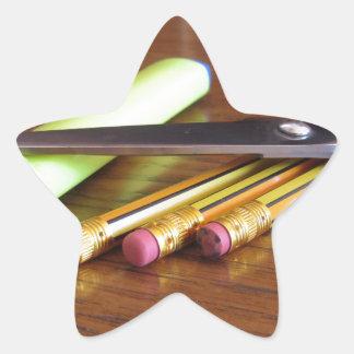 School office supplies on wooden table star sticker