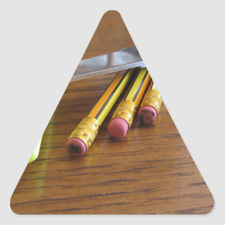 School office supplies on wooden table triangle sticker