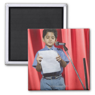 Schoolboy giving speech on a stage magnet