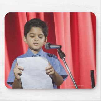 Schoolboy giving speech on a stage mouse pad