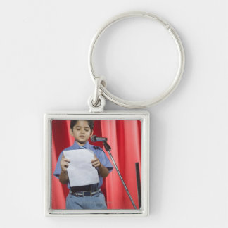Schoolboy giving speech on a stage Silver-Colored square keychain