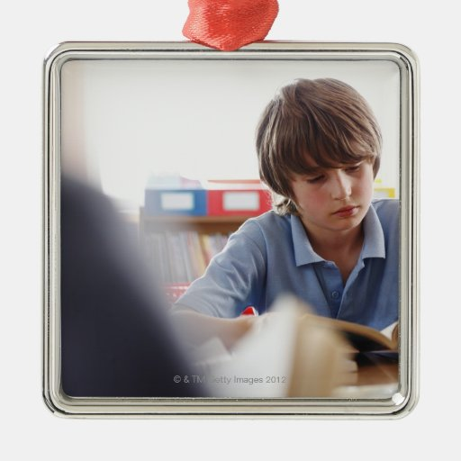 schoolboy reading in classroom christmas ornament