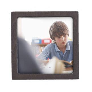 schoolboy reading in classroom keepsake box