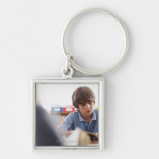 schoolboy reading in classroom Silver-Colored square keychain