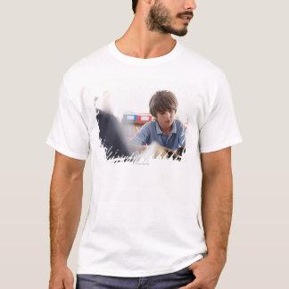 schoolboy reading in classroom T-Shirt