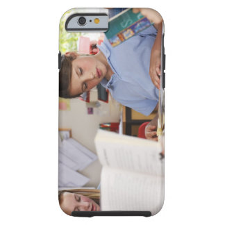 schoolgirl concentrating on reading in class tough iPhone 6 case