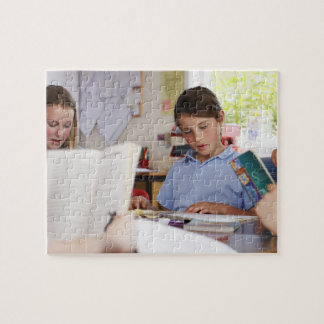schoolgirl concentrating on reading in class jigsaw puzzle