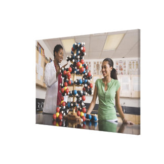 Science teacher and teenage girl looking at canvas print