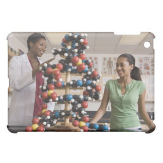 Science teacher and teenage girl looking at cover for the iPad mini