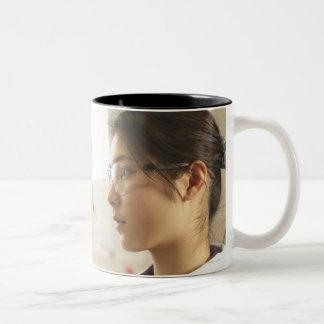 Scientist examining liquid in beaker Two-Tone coffee mug