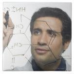 Scientist writing chemical formula 2 large square tile