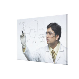 Scientist writing chemical formula stretched canvas prints