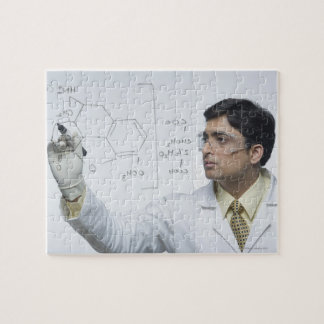 Scientist writing chemical formula jigsaw puzzle
