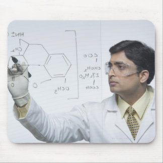 Scientist writing chemical formula mouse pad