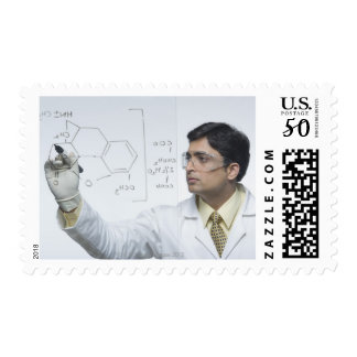 Scientist writing chemical formula postage