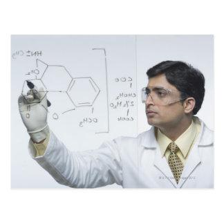 Scientist writing chemical formula postcard