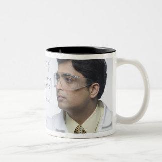Scientist writing chemical formula Two-Tone coffee mug