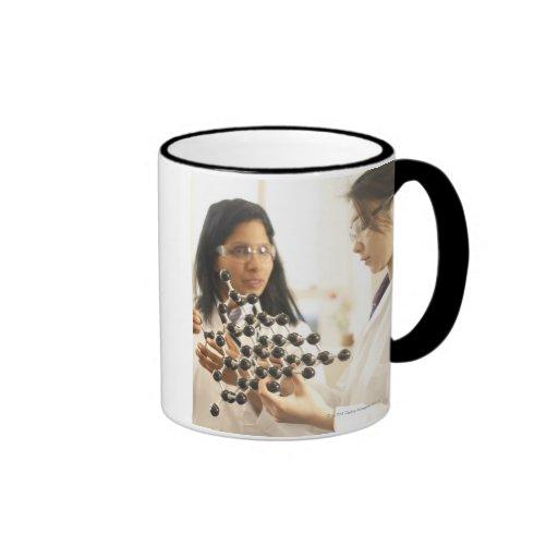 Scientists examining molecular model coffee mugs
