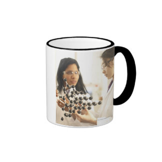Scientists examining molecular model ringer mug