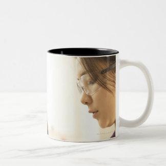 Scientists examining molecular model Two-Tone coffee mug