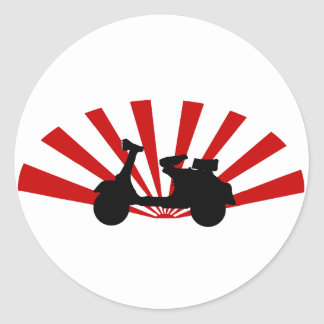 Scooter with rising sun background classic round sticker