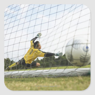 Scoring a goal square sticker
