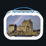 "Scotland, Highland, Wester Ross, Eilean Donan Lunch Box<br><div class=""desc"">Scotland,  Highland,  Wester Ross,  Eilean Donan Castle A rainbow greets visitors at Eilean Donan Castle on Loch Doich in the Highland of Scotland   Ric Ergenbright / DanitaDelimont.com</div>"