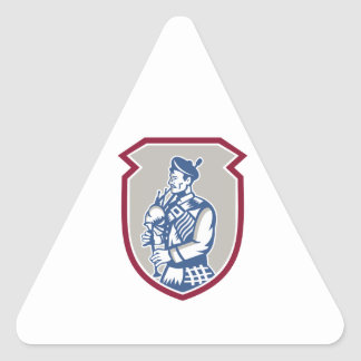 Scotsman Bagpiper Playing Bagpipes Shield Triangle Sticker
