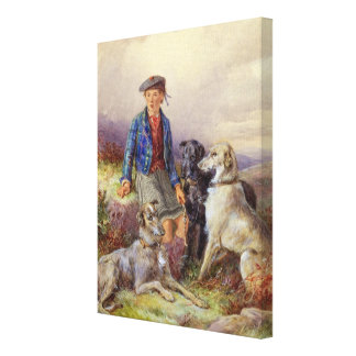 Scottish boy with wolfhounds in a Highland landsca Canvas Print