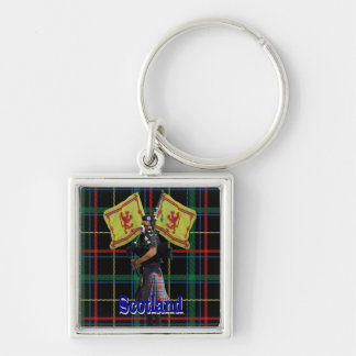 Scottish piper on tartan keychain