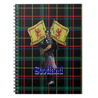 Scottish piper on tartan spiral notebook