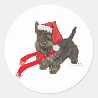 Scottish Terrier is Santa's Helper Classic Round Sticker