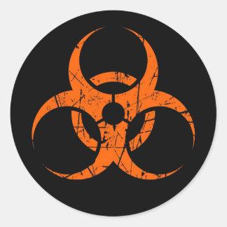 Scratched Orange Biohazard Symbol on Black Classic Round Sticker