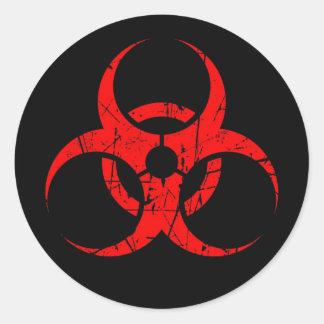 Scratched Red Biohazard Symbol on Black Round Sticker