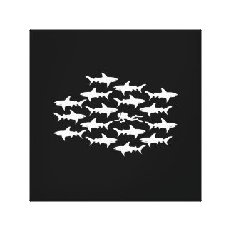 Scuba Diver Swimming with a School of Sharks Canvas Print