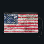 "Scuffed and Worn American Flag Wristlet<br><div class=""desc"">This American flag is finished with rough textures and scuff marks. This unique flag of The United States pattern has an old worn out feel that gives it a stylish look. This patriotic design is perfect to show off country pride.</div>"