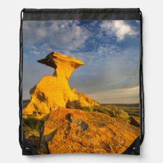 Sculpted Badlands Formation In Short Grass Drawstring Bag