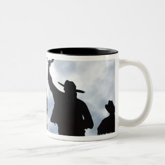 sculpture that welcomes you to Dodge City Kansas 2 Two-Tone Coffee Mug