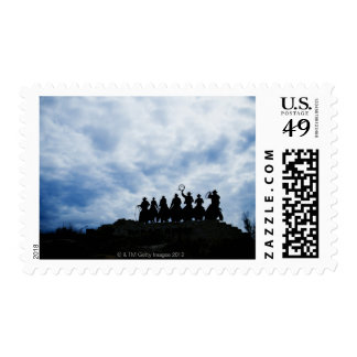 sculpture that welcomes you to Dodge City Kansas Postage Stamps