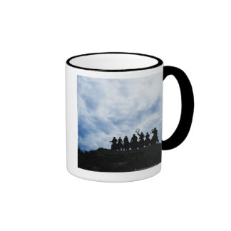 sculpture that welcomes you to Dodge City Kansas Ringer Coffee Mug