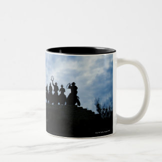 sculpture that welcomes you to Dodge City Kansas Two-Tone Coffee Mug