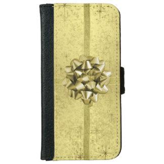 Se asemeja a un regalo del navidad envuelto en funda cartera para iPhone 6