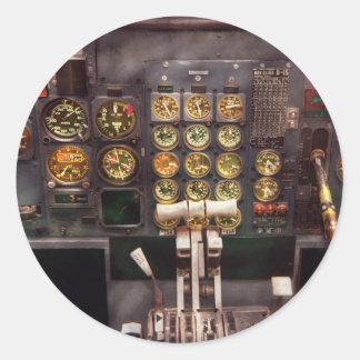 Se fija el avión - carlinga - los controles pegatina redonda