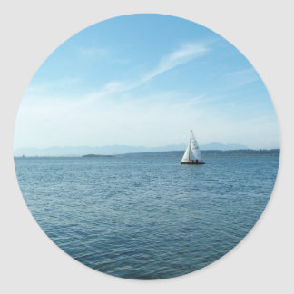 sea and sail boat under blue sky classic round sticker