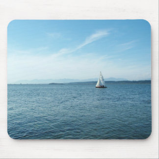 sea and sail boat under blue sky mouse pad
