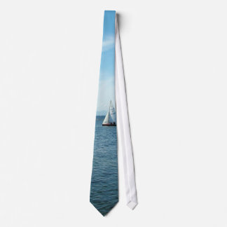 sea and sail boat under blue sky neck tie