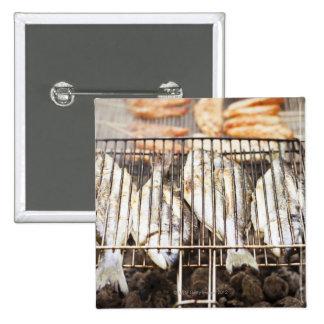 Sea breams on barbecue grill. 2 inch square button