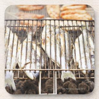Sea breams on barbecue grill. beverage coaster
